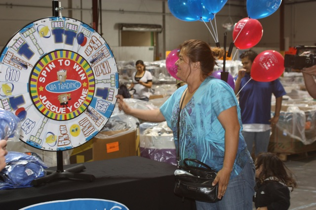 A lucky winner spinning the wheel for her free gift!